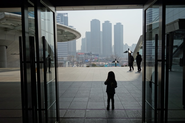 """daughter eva, on a day when pollution in seoul measured """"hazardous for all groups,"""" not just children and old people."""